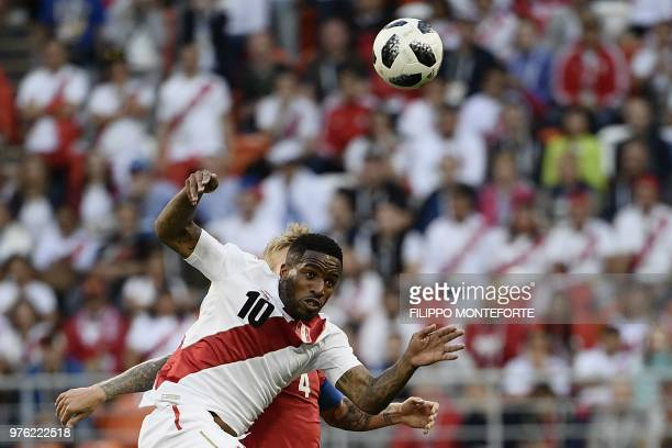 TOPSHOT Peru's forward Jefferson Farfan vies for the ball with Denmark's defender Simon Kjaer as they head the ball during the Russia 2018 World Cup...