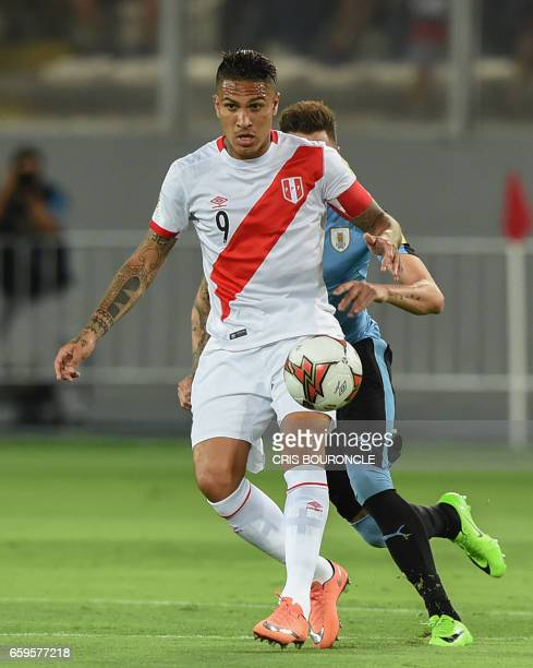 Peru's forward Paolo Guerrero and Uruguay's Jose Maria Gimenez vie for the ball during the 2018 FIFA World Cup qualifier football match in Lima on...