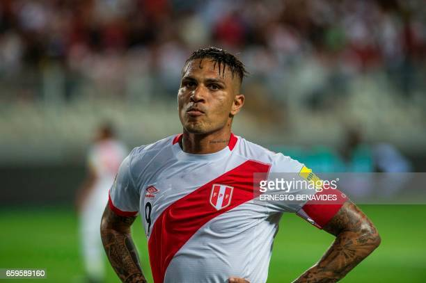 Peru's forward Paolo Guerrero gestures during the 2018 FIFA World Cup qualifier football match Peru vs Uruguay in Lima on March 28 2017 / AFP PHOTO /...