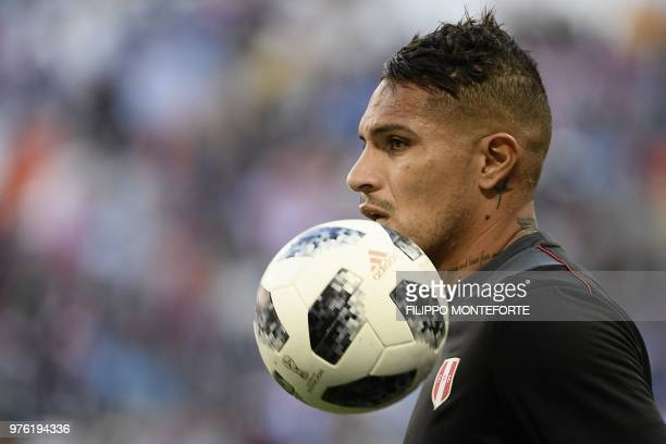 Peru's forward Paolo Guerrero looks on as he warms up prior to the Russia 2018 World Cup Group C football match between Peru and Denmark at the...
