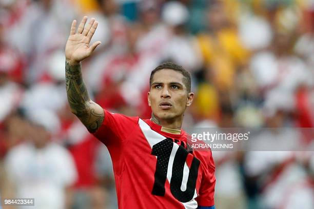 Peru's forward Paolo Guerrero waves after winning the Russia 2018 World Cup Group C football match between Australia and Peru at the Fisht Stadium in...