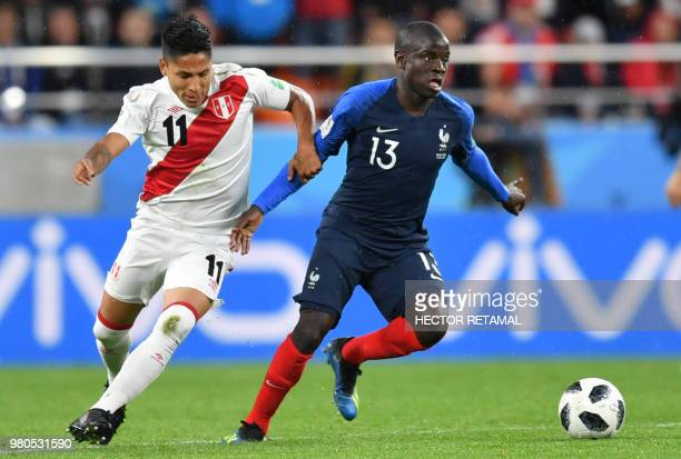 Peru's forward Raul Ruidiaz and France's midfielder N'Golo Kante compete for the ball during the Russia 2018 World Cup Group C football match between...