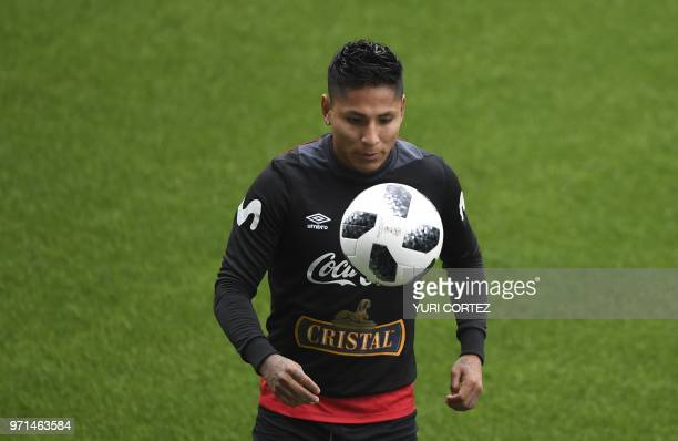 Peru's forward Raul Ruidiaz controls the ball during a training session at the Arena Khimki stadium outside Moscow on June 11 ahead of the Russia...