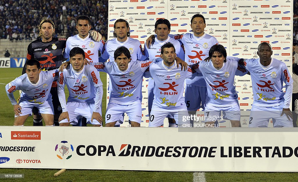 Peru's Garcilaso team pose before their 2013 Copa Libertadores football match against Uruguay's Nacional players held at the Garcilaso de la Vega stadium, in Cuzco, Peru on April 25, 2013.