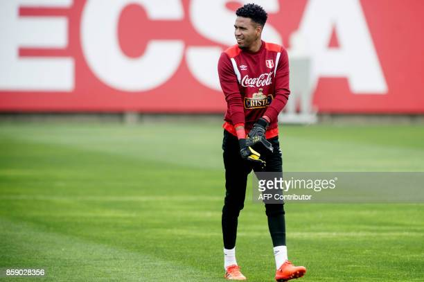 Peru's goalkeeper Pedro Gallese arrives to a training session in Lima on October 8 2017 ahead of their FIFA 2018 World Cup South American qualifier...