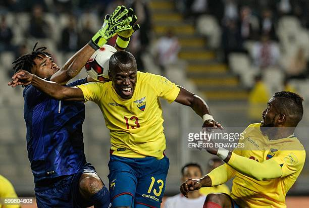 Peru's goalkeeper Pedro Gallese catches the ball next to Ecuador's Enner Valencia during their Russia 2018 World Cup football qualifier match in Lima...