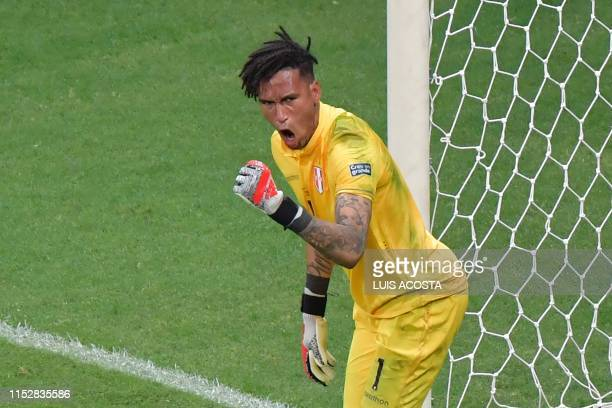 Peru's goalkeeper Pedro Gallese celebrates after stopping the penalty taken by Uruguay's Luis Suarez during the shootout after tying 00 during their...