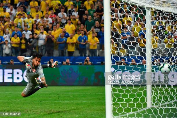 TOPSHOT Peru's goalkeeper Pedro Gallese eyes the ball as it goes into the goal after a strike by Brazil's Willian during their Copa America football...