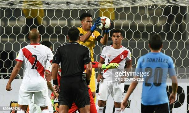 Peru's goalkeeper Pedro Gallese grabs a ball during the 2018 FIFA World Cup qualifier football match Peru vs Uruguay in Lima on March 28 2017 / AFP...