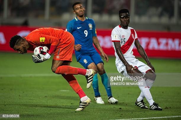 Peru's goalkeeper Pedro Gallese grabs a ball next to Brazil's Gabriel Jesus and Peru's defender Christian Ramos during their 2018 FIFA World Cup...