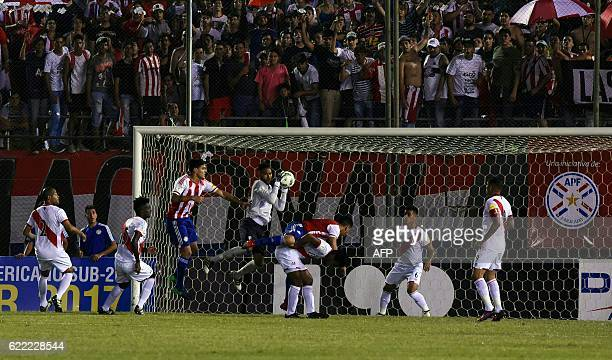 Peru's goalkeeper Pedro Gallese grabs the ball during their FIFA 2018 World Cup qualifier football match against Paraguay in Asuncion on November 10...
