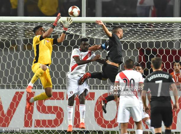Peru's goalkeeper Pedro Gallese jumps for the ball during their 2018 World Cup qualifying playoff second leg football match against New Zealand in...