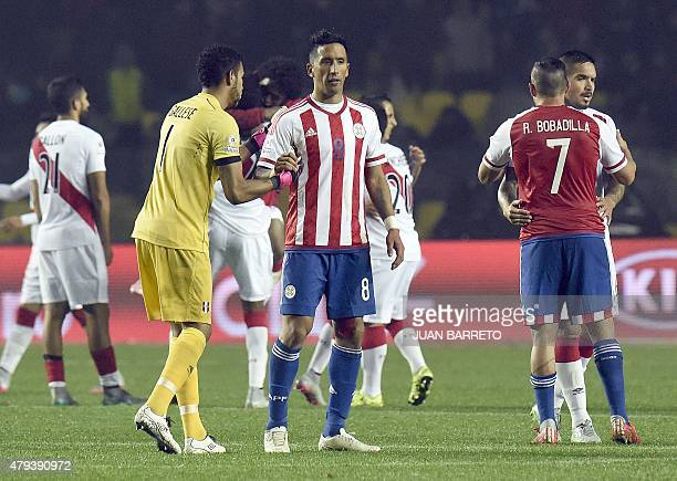 Peru's goalkeeper Pedro Gallese shakes hands with Paraguay's forward Lucas Barrios at the end of their Copa America third place football match in...