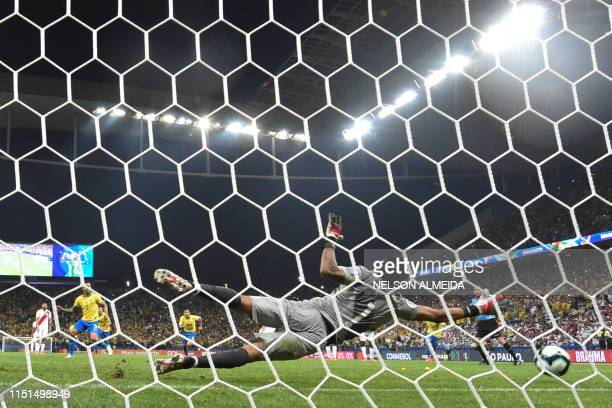 Peru's goalkeeper Pedro Gallese stops a penalty to Brazil's Gabriel Jesus during their Copa America football tournament group match at the...