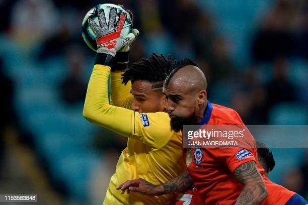 Peru's goalkeeper Pedro Gallese traps the ball next to Chile's Arturo Vidal during their Copa America football tournament semifinal match at the...