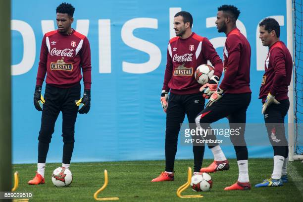 Peru's goalkeepers Pedro Gallese Carlos Caceda Jose Carvallo and Leao Butron during a training session in Lima on October 8 2017 ahead of their FIFA...