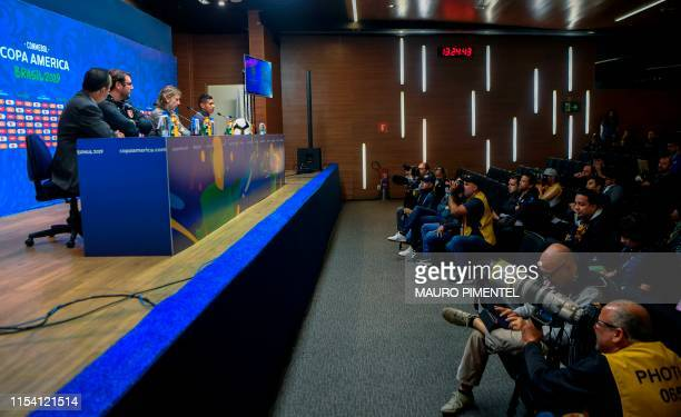 Peru's head coach Ricardo Gareca and Peru's football player Edison Flores take part in a press conference of the Peruvian football team at Maracana...