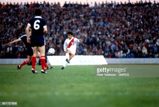 Peru's Hector Chumpitaz clears from Scotland's Kenny Dalglish