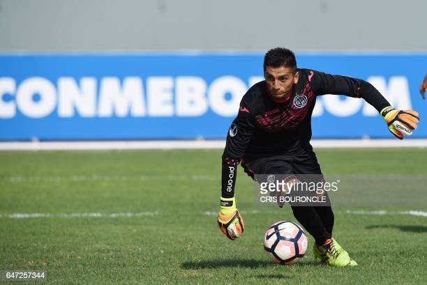 Peru's Juan Aurich goalkeeper Jesus Cisneros tries to grab the ball during the Copa Sudamericana football match against Argentina's Arsenal at the...