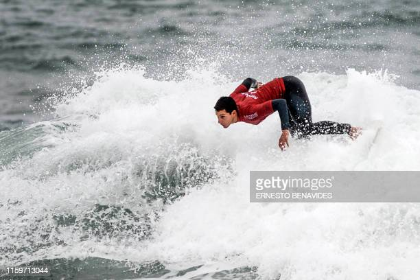 Peru's Luca Mesinas competes to win Gold in the Men's Open Surfing competition during the Lima 2019 Pan American Games at Punta Rocas beach in Lima...