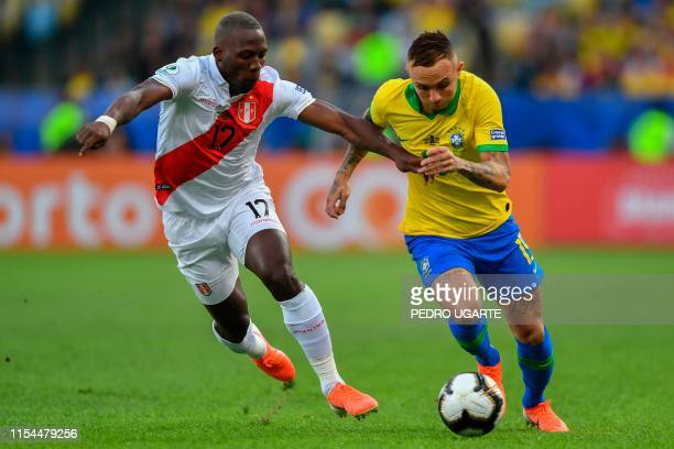 Peru's Luis Advincula and Brazil's Everton vie for the ball during their Copa America football tournament final match at Maracana Stadium in Rio de...