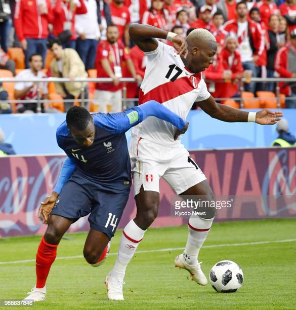 Peru's Luis Advincula defends the ball from France's Blaise Matuidi during the first half of a World Cup Group C match in Ekaterinburg Russia on June...