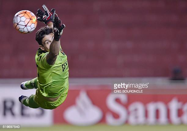 Peru's Melgar goalkeeper Daniel Ferreyra jumps for the ball during their Copa Libertadores football match against Chiles Colo Colo at the Mariano...