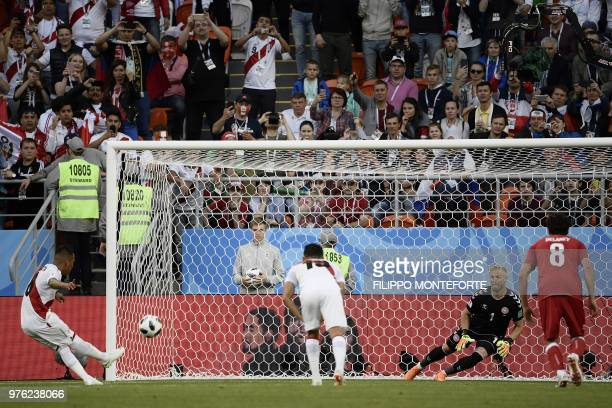 Peru's midfielder Christian Cueva fails his penalty kick during the Russia 2018 World Cup Group C football match between Peru and Denmark at the...