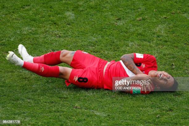 TOPSHOT Peru's midfielder Christian Cueva reacts after being fouled during the Russia 2018 World Cup Group C football match between Australia and...