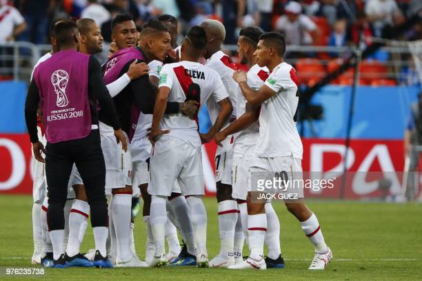 Peru's midfielder Christian Cueva reacts as he is consoled by his teammates after failing his penalty kick during the Russia 2018 World Cup Group C...