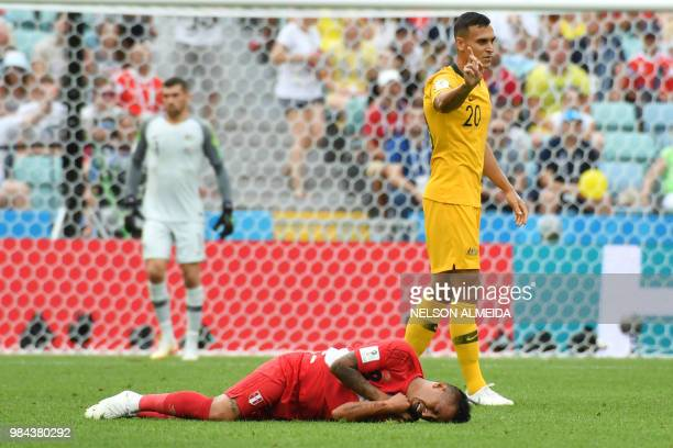 Peru's midfielder Christian Cueva reacts on the ground next to Australia's defender Trent Sainsbury during the Russia 2018 World Cup Group C football...