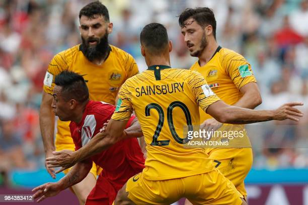 Peru's midfielder Christian Cueva vies for the ball with Australia's midfielder Mile Jedinak Australia's defender Trent Sainsbury and Australia's...