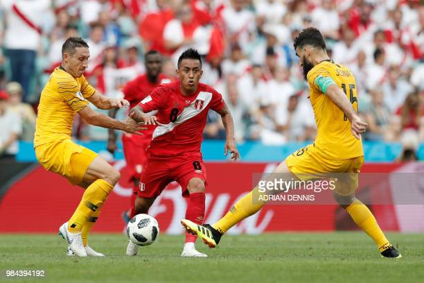 Peru's midfielder Christian Cueva vies for the ball with Australia's defender Mark Milligan and Australia's midfielder Mile Jedinak during the Russia...