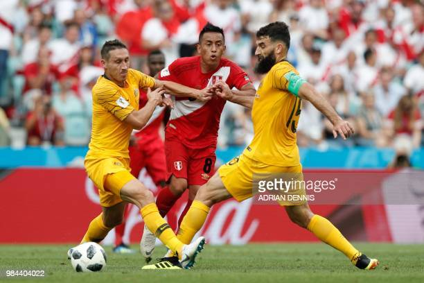 Peru's midfielder Christian Cueva vies for the ball with Australia's midfielder Mile Jedinak and Australia's defender Mark Milligan during the Russia...
