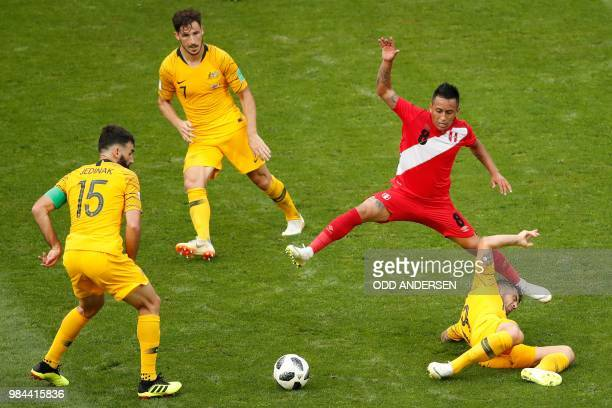 TOPSHOT Peru's midfielder Christian Cueva vies for the ball with Australia's midfielder Mile Jedinak Australia's forward Mathew Leckie and...