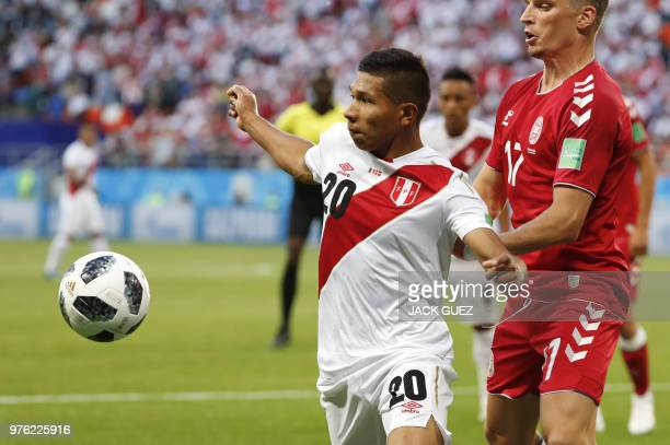 Peru's midfielder Edison Flores eyes the ball as he vies for it with Denmark's defender Jens Stryger Larsen during the Russia 2018 World Cup Group C...