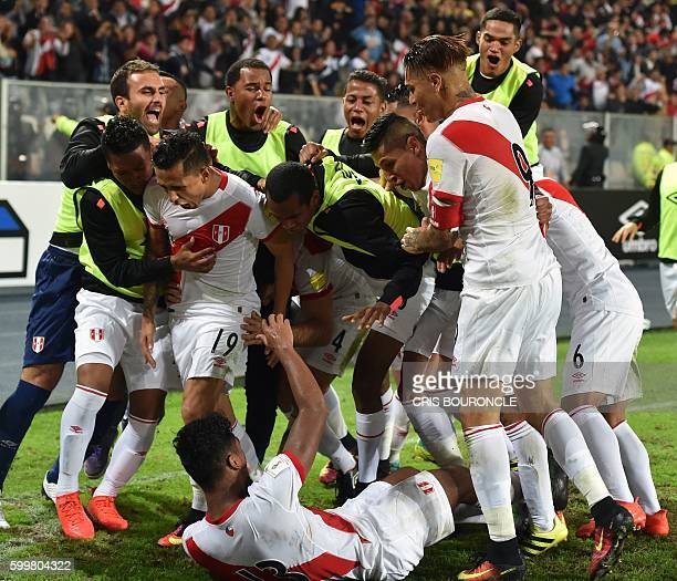 Peru's midfielder Renato Tapia celebrates with teammates after scoring against Ecuador during their Russia 2018 World Cup football qualifier match in...