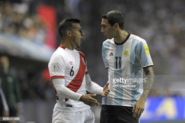 Peru's Miguel Trauco and Argentina's Angel Di Maria argue during their 2018 World Cup qualifier football match in Buenos Aires on October 5 2017 /...