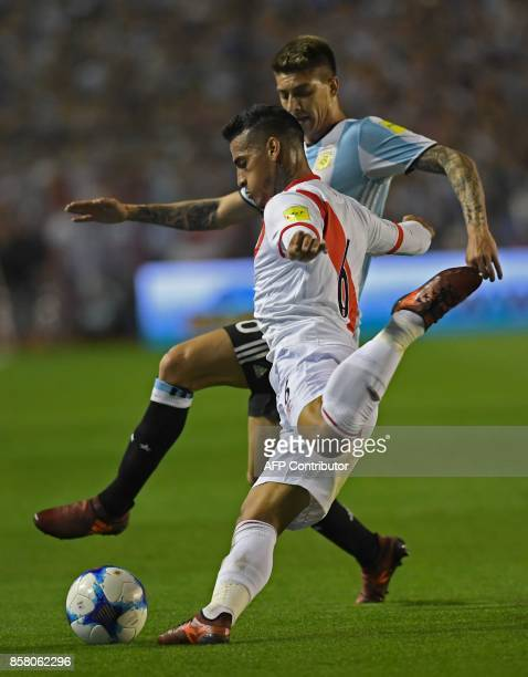 Peru's Miguel Trauco and Argentina's Leandro Paredes vie for the ball during their 2018 World Cup football qualifier match in Buenos Aires on October...