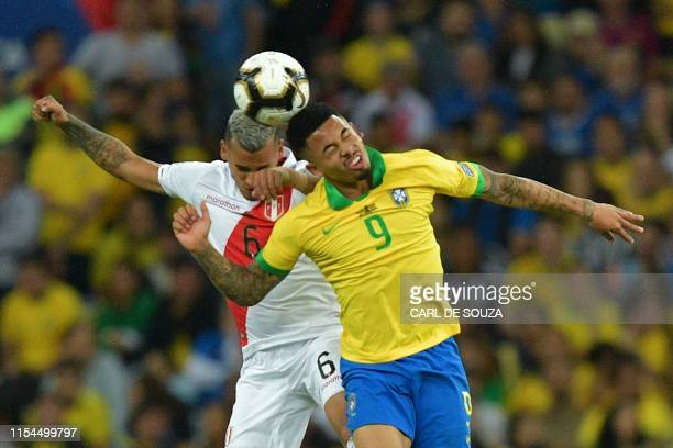 Peru's Miguel Trauco and Brazil's Gabriel Jesus jump for a header during their Copa America football tournament final match at Maracana Stadium in...