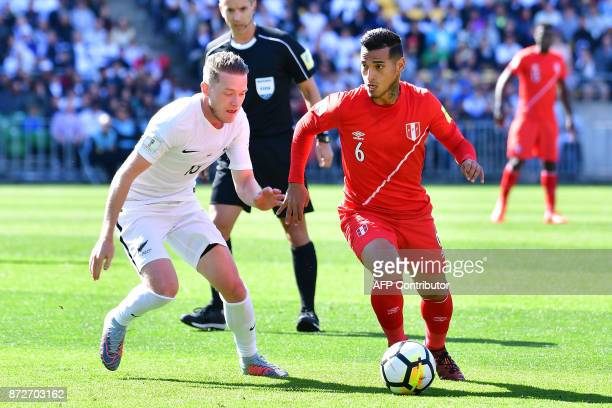 Peru's Miguel Trauco controls the ball next to New Zealand's Shane Smeltz during the World Cup football qualifying match between New Zealand and Peru...