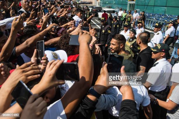 Peru's national football team captain Paolo Guerrero arrives at the Jorge Chavez airport in Lima on May 15 2018 a day after the Court of Arbitration...
