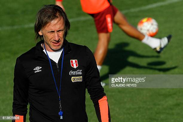 Peru's national football team coach Ricardo Gareca walks during a training session in Santiago Chile on October 10 on the eve of their FIFA World Cup...