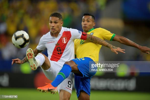 Peru's Paolo Guerrero and Brazil's Alex Sandro vie for the ball during their Copa America football tournament final match at Maracana Stadium in Rio...
