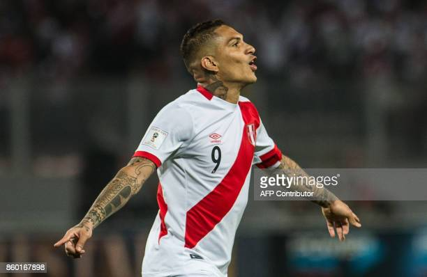 Peru's Paolo Guerrero celebrates after scoring against Colombia during their 2018 World Cup qualifier football match in Lima on October 10 2017 / AFP...
