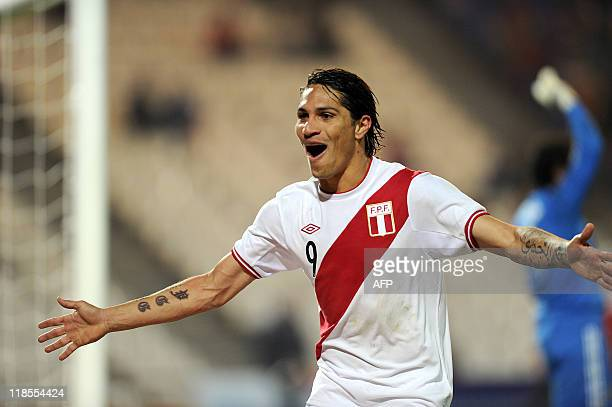 Peru´s Paolo Guerrero celebrates after scoring against Mexico during a 2011 Copa America Group C first round football match held at the Malvinas...