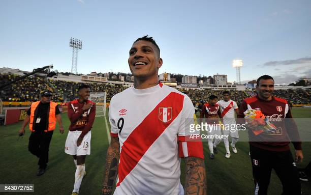 Peru's Paolo Guerrero celebrates at the end of their 2018 World Cup qualifier football match against Ecuador in Quito on September 5 2017 / AFP PHOTO...