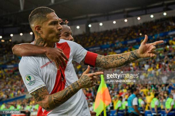 Peru's Paolo Guerrero celebrates with teammate Peru's Andre Carrillo after scoring against Brazil during the Copa America football tournament final...