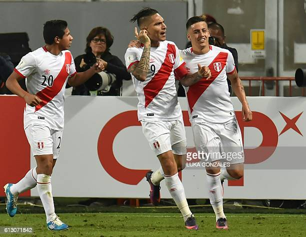 Peru's Paolo Guerrero celebrates with teammates after scoring against Argentina during their Russia 2018 World Cup qualifier football match in Lima...