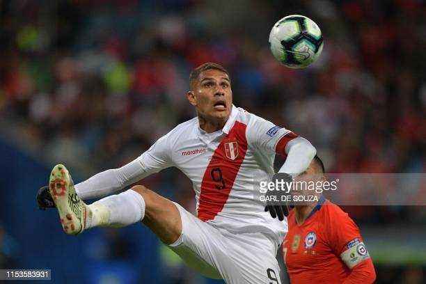 TOPSHOT Peru's Paolo Guerrero controls the ball over Chile's Gary Medel during their Copa America football tournament semifinal match at the Gremio...